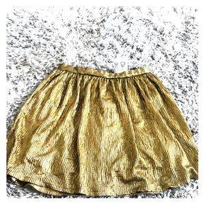 NWT Gold mini skirt size 7